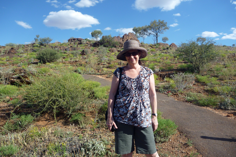 Mum on a bush walk up to the Living Desert Sculpures